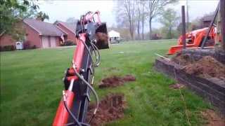 getlinkyoutube.com-Harbor Freight trencher / backhoe and the Kubota L3200 digging holes for posts