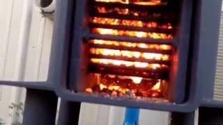 getlinkyoutube.com-Rocket stove burning on pellets 15 hour burn time on three quarters of a bag wide open