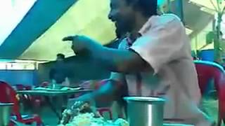 A indian man eating food