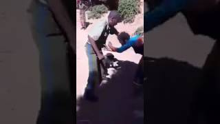 Zambia police beating his wife
