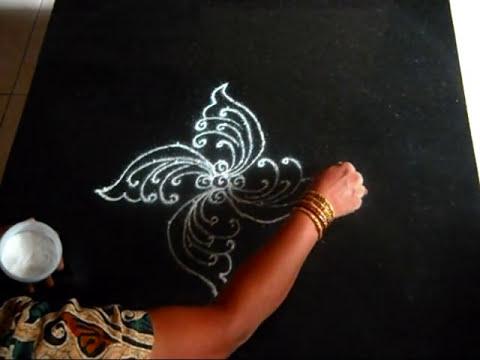 A peacock kolam or rangoli (9-1 dots)