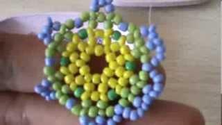 getlinkyoutube.com-Flor Tejida de tres colores.