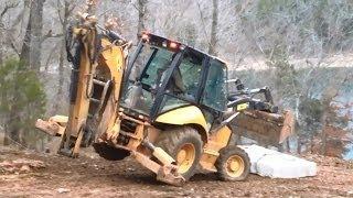 getlinkyoutube.com-Cat 420E Backhoe Moving a 7000 Pound Limestone Block