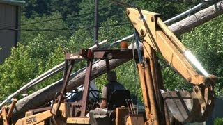 getlinkyoutube.com-Backhoe Snapped Power Pole Operator Is Trapped Under Live Lines Fife WA