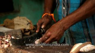 getlinkyoutube.com-Local traders cut freshly caught fish at a market in Chennai