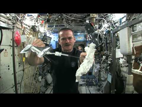 Wet Washcloth In Space - What Happens When You Wring It? | Video