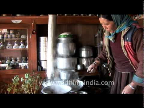 Woman cooking food in Ladakh