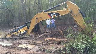 getlinkyoutube.com-Stuck Trackhoe Excavator Buried Rental Disaster Caterpillar Part 1…