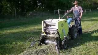 getlinkyoutube.com-Baling Hay using BCS tractor and CAEB baler