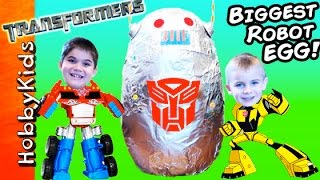 World's BIGGEST ROBOT Surprise Egg! Fighting Transformers + BEST Toys HobbyKidsTV