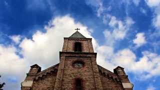 The facade of the church against the sky