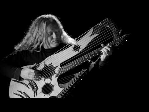 Man Invents 27 String Guitar