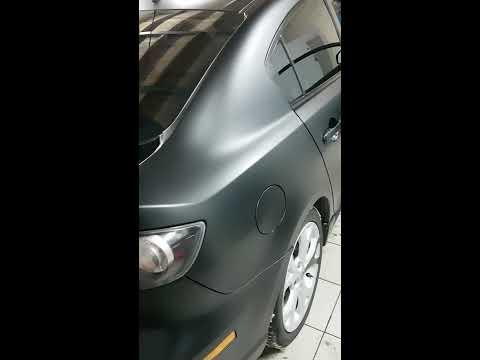 Открытие люка бензобака Мазда 3 2007