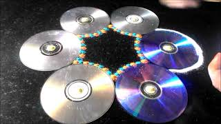 getlinkyoutube.com-Innovative rangoli designs using rangoli making techniques tips tricks with CD and buds