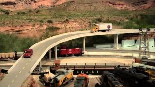 getlinkyoutube.com-LCJ&I Lines, 23. Building a highway and red rock scenery
