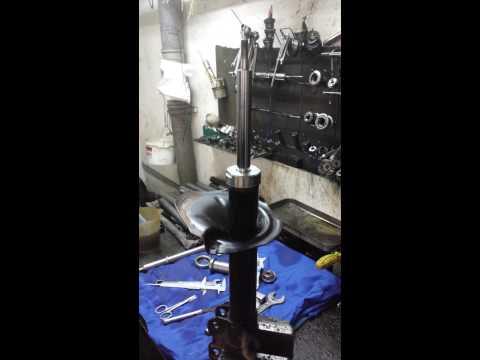 Отремонтированная стойка Geely MK Cross