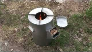 getlinkyoutube.com-DIY gravity feed rocket stove - burning wood pellets (sawdust granules)