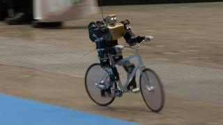 getlinkyoutube.com-Amazing Bike Riding Robot! Can Cycle, Balance, Steer, and Correct Itself. #DigInfo