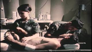 Doctors and Nurse examine wounded United States soldier HD Stock Footage