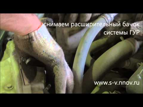 Где находится у Додж Stratus натяжной ролик ремня генератора