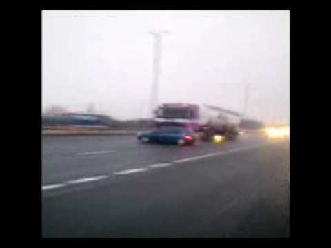 Truck Pushes Car Down Highway at High Rate of Speed