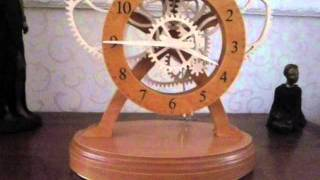 Battery operated electromechanical wooden gear clock..wmv