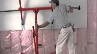 getlinkyoutube.com-Installing drywall on upper walls with lift by Laurier Desormeaux