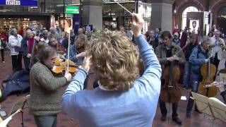 getlinkyoutube.com-Flash mob at Copenhagen Central Station. Copenhagen Phil playing Ravel's Bolero.