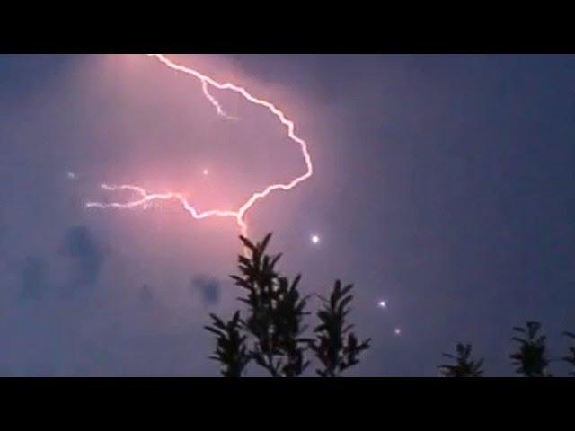 Spectacular UFOs flying through Lightning Strike, June 2014