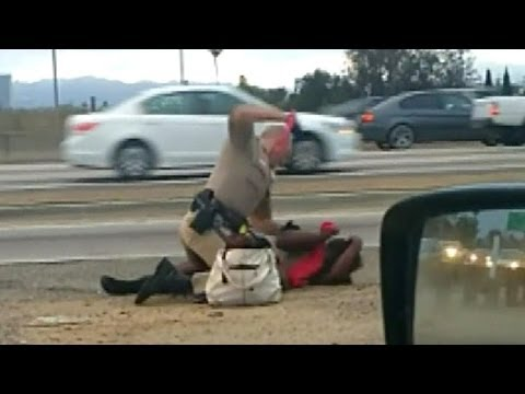 LAPD Cop Bashes Woman In The Face