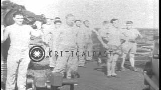 getlinkyoutube.com-Men standing near a deck gun and doing physical drill aboard USS Nautilus underwa...HD Stock Footage