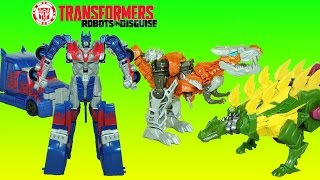 getlinkyoutube.com-Transformers Optimus Prime Grimlock & Snarl Power Attackers Dinobots Transform and Play