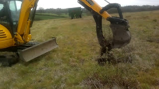 JCB 8045 with RSL fixed thumb grab pulling old briar roots and willow stumps