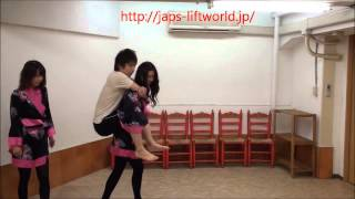 Two Japanese girlsin Kimono lift and carry guy