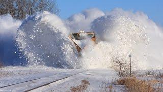 getlinkyoutube.com-Awesome Powerful Train plow through snow railway tracks -  Video  | HD