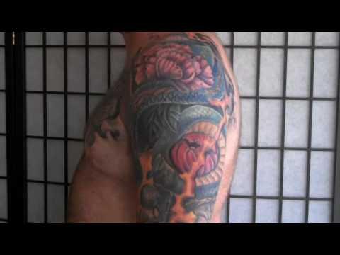 Tattooed Sleeve on James Edmonds. Dragon and koi tattooed sleeve by artist