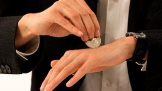 getlinkyoutube.com-How to Pass a Coin through the Hand | Coin Tricks