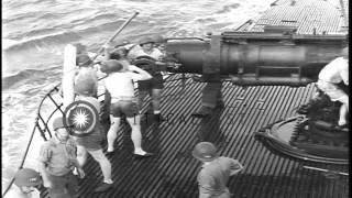getlinkyoutube.com-Men loading and firing a gun aboard USS Nautilus underway in the Pacific Ocean. HD Stock Footage