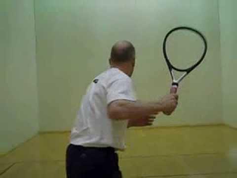 Joel practicing tennis in racquetball court