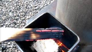 getlinkyoutube.com-ROCKET STOVE HEATER FIRST BURN part 2