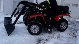 ATV quad loader in action snow removal