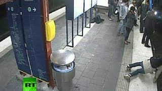 getlinkyoutube.com-Shock CCTV: Man falls onto tracks, gets robbed and run over by train
