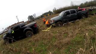 getlinkyoutube.com-Ford Raptor pulls out Chevy 2500 HD with trailer and 4wheelers