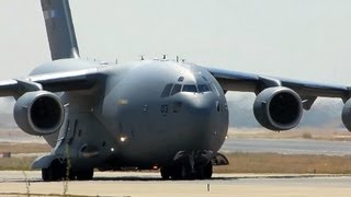 C-17 GLOBEMASTER III taking off with dust width=