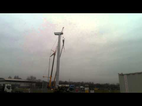 Lifting wind turbine blade into place