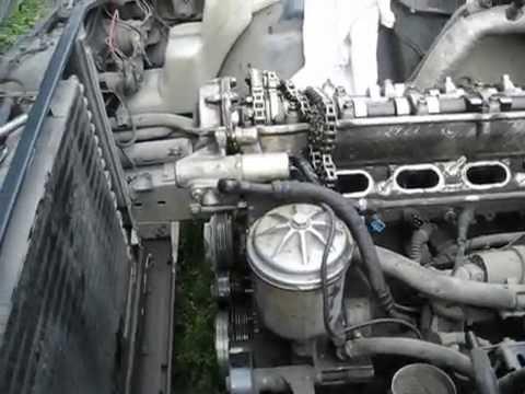 Где находится в BMW E34 натяжитель цепи грм