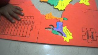 Enthusiastic kid arranging States of India
