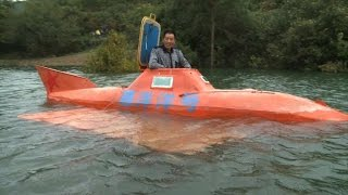 getlinkyoutube.com-Chinese farmer finds new life in an orange submarine