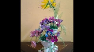 getlinkyoutube.com-Best Out Of Waste Plastic Egg tray transformed to Colourful Flowers Showpiece