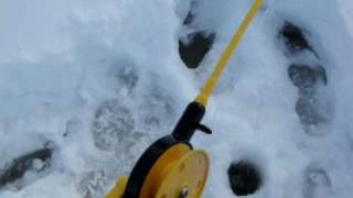 Finland Yllas icefishing on a frozen lake